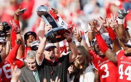 Head coach Tom Herman of the Houston Cougars raises the AAC Championship Trophy after defeating the Temple Owls at TDECU Stadium on December 5, 2015 in Houston, Texas. Houston won 24-13.