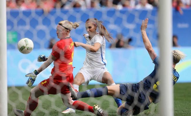 Alex Morgan of U.S. shoots against Hedvig Lindahl and Nilla Fischer of Sweden.