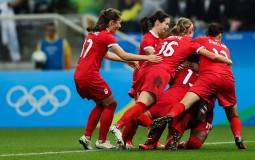Sophie Schmidt #13 of Canada celebratestheir first goal against France.