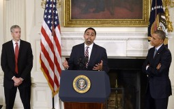 Deputy Education Secretary John B. King Jr. (C) delivers remarks after being nominated by U.S. President Barack Obama (R)