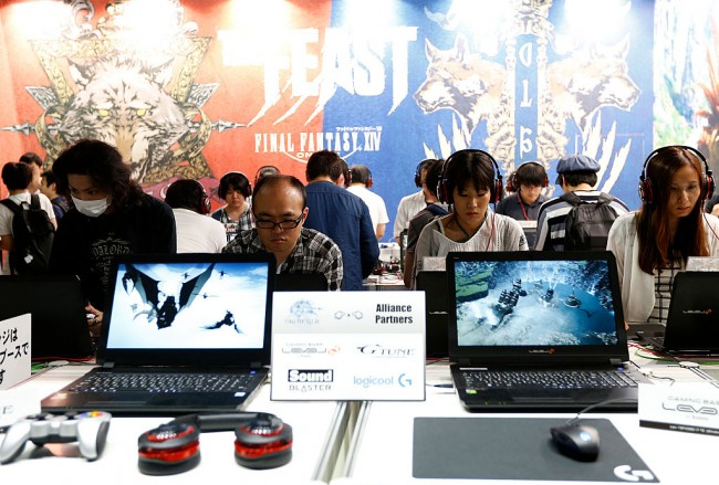 Visitors play the Final Fantasy XIV in the Square Enix Co. booth at Tokyo Game Show on September 17, 2016.