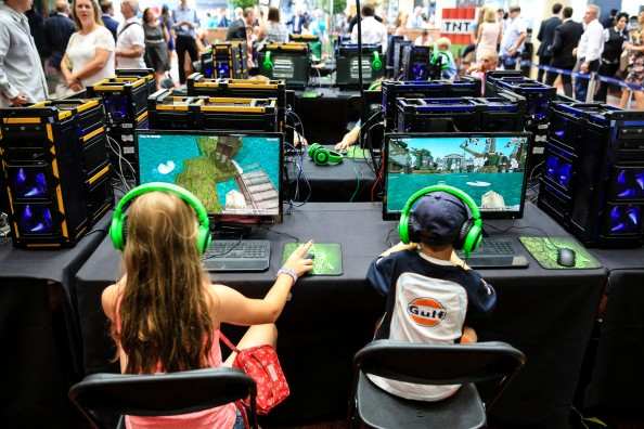 Young racegoers play in a Minecraft tournament during Ascot Dubai Duty Free Shergar Cup and Concert