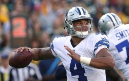 Dak Prescott #4 of the Dallas Cowboys attempts a pass against the Green Bay Packers during the second quarter at Lambeau Field