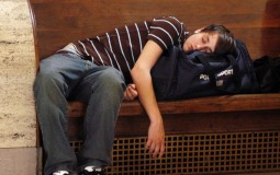 Young man taking a nap on the way home.