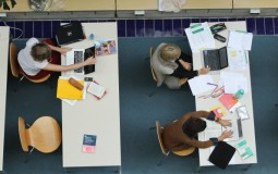Students studying inside the school library