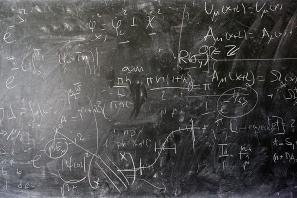 A blackboard full of mathematical physics equations