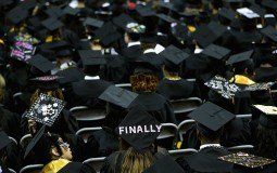 Graduates of Bowie State University put messages on their mortarboard hats during the school's graduation ceremony