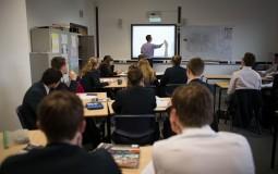 A professor discusses lesson in class.