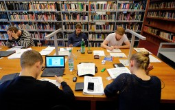 College students diligently study in the library