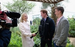 Prince Harry chats to Louise Minchin from BBC Breakfast as they visit the Sentebale 'Hope In Vunerability' Garden