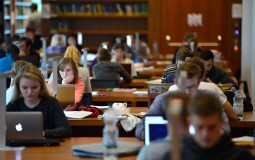 College entrepreneurship students studying in the university library.