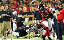 Harry Douglas #83 of the Atlanta Falcons runs with a catch against Kyle Arrington #25 of the New England Patriots