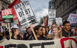 Protestors march during a protest against education cuts and tuition fees