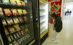 A student buys snacks from a vending machine