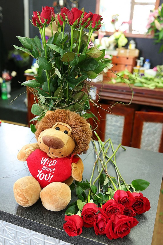 A Valentine's Day bear and roses displayed