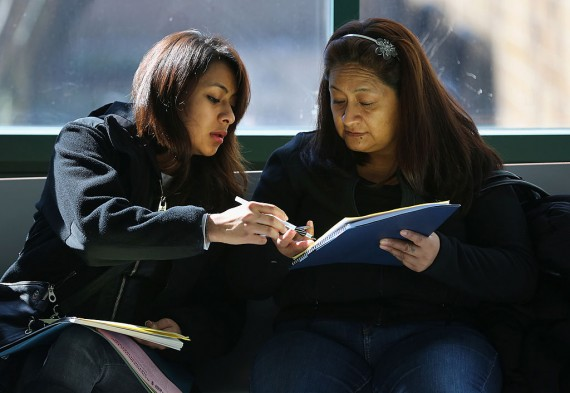 Mother assists daughter with the college applications