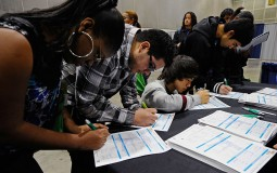 Low income students filling out applications for scholarship programs and financial aids