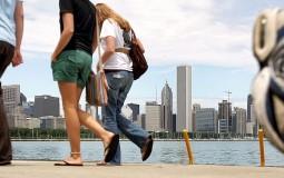 People taking a walk along Lake Michigan