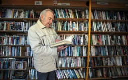 An old man reading a book